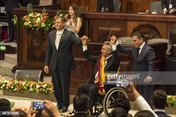 Former Ecuadorian president Rafael Correa left raises the hand of Lenin Moreno Ecuador's president during the presidential inauguration at the the...
