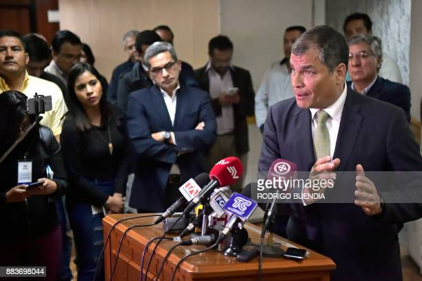 Former Ecuadorian president Rafael Correa talks to the press at the National Court of Justice in Quito after paying a visit to indicted Ecuadorean...