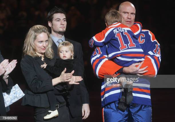 Former Edmonton Oilers great Mark Messier looks on with his girlfriend Kim Clark daughter Jacqueline Jean sons Douglas Paul and Lyon during a...