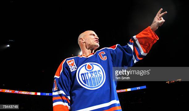 Former Edmonton Oilers great Mark Messier salutes his fans as he takes a final skate around the ice during a ceremony to raise his banner to the...