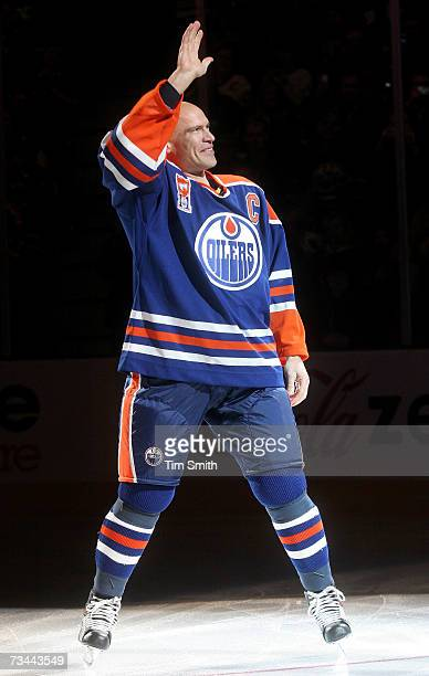 Former Edmonton Oilers great Mark Messier waves to his fans as he takes a final skate around the ice after a ceremony to raise his banner to the...
