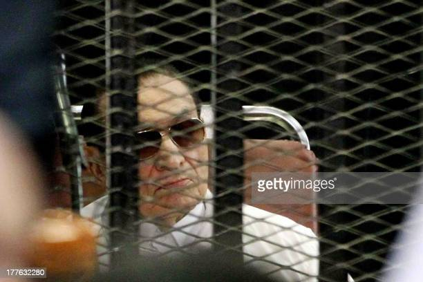 Former Egyptian president Hosni Mubarak is seen behind bars during his retrial on August, 25 2013 in Cairo. An Egyptian court on Sunday adjourned the...