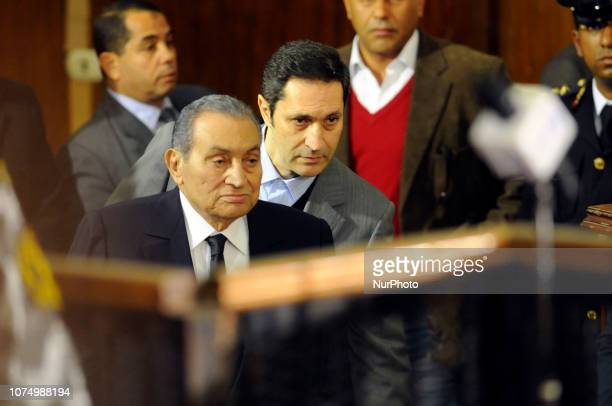 Former Egyptian president Hosni Mubarak who was ousted following a popular uprisal in 2011 arrives with his sons Alaa to testify during a session in...