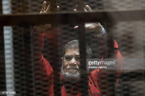 Former Egyptian President Mohamed Morsi, wearing a red uniform after Cairo Criminal Court on Tuesday sentenced him to death over a prison break in...