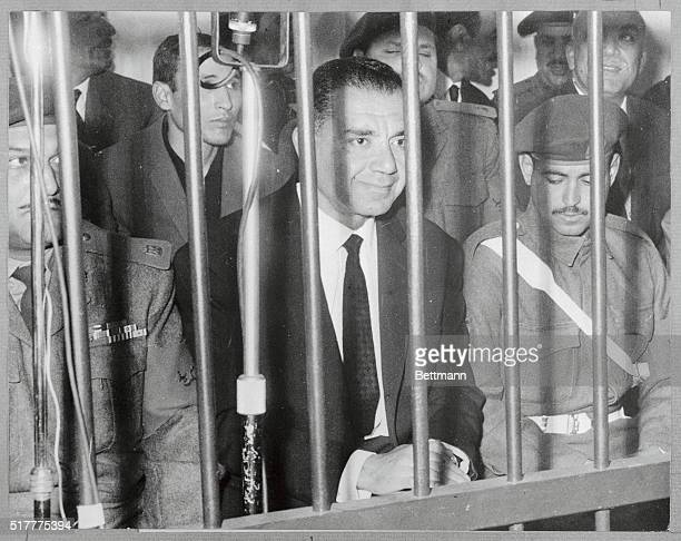 Former Egyptian War Minister Shams Badran is flanked by military men during his trial before the Revolution Command Council on January 22nd Badran...