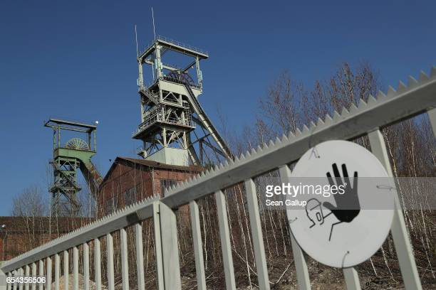 Former elevator towers of the defunct Luisenthal coal mine stand on March 16 2017 in Voelklingen Germany Voelklingen is in the industrial heartland...