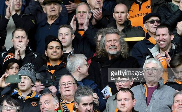 Former Elf Zeppelin singer Robert Plant a fan of Wolverhampton Wanderers celebrates promotion to the Premier League during the Sky Bet Championship...