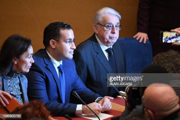 Former Elysee senior security officer Alexandre Benalla flanked by Senator and commisision speaker JeanPierre Sueur is pictured by photographers as...