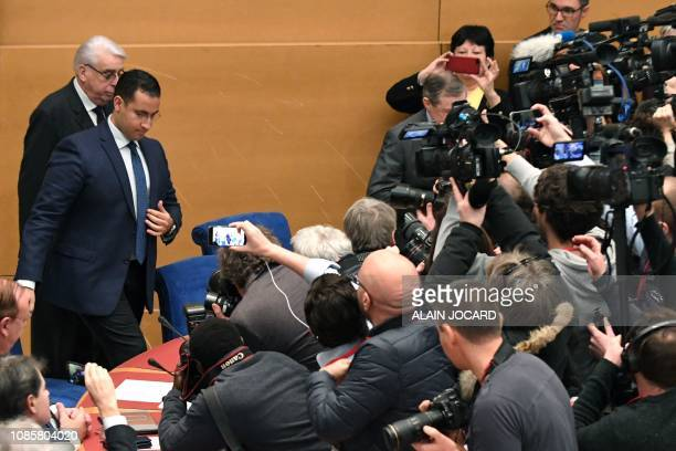 Former Elysee senior security officer Alexandre Benalla flanked by Senator and commisision speaker JeanPierre Sueur is surrounded by journalists as...