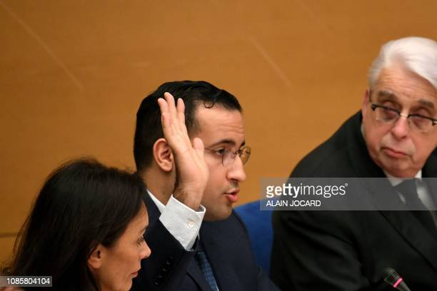 Former Elysee senior security officer Alexandre Benalla flanked by Senator and commisision speaker JeanPierre Sueur raises his hand to swear an oath...