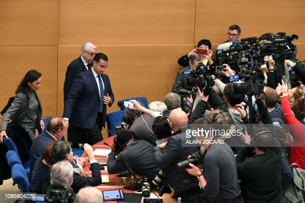 TOPSHOT Former Elysee senior security officer Alexandre Benalla flanked by Senator and commisision speaker JeanPierre Sueur is surrounded by...
