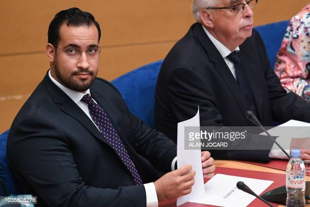 Former Elysee senior security officer Alexandre Benalla looks over prior to the start a Senate committee in Paris on September 19 2018 The disgraced...