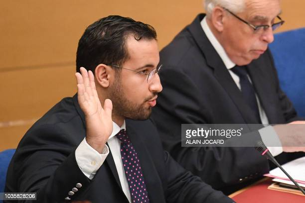 TOPSHOT Former Elysee senior security officer Alexandre Benalla raises his hand as he takes the oath before a Senate committee in Paris on September...