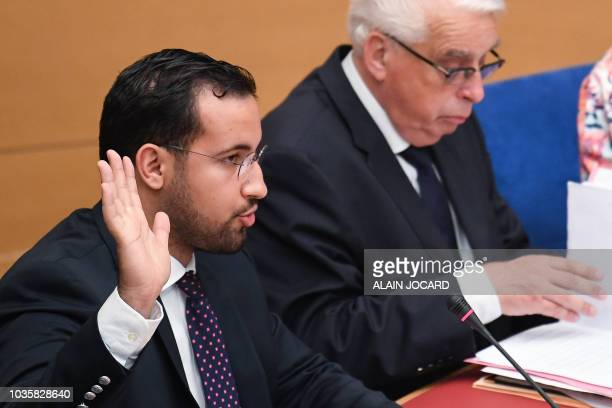 Former Elysee senior security officer Alexandre Benalla raises his hand as he takes the oath before a Senate committee in Paris on September 19 2018...