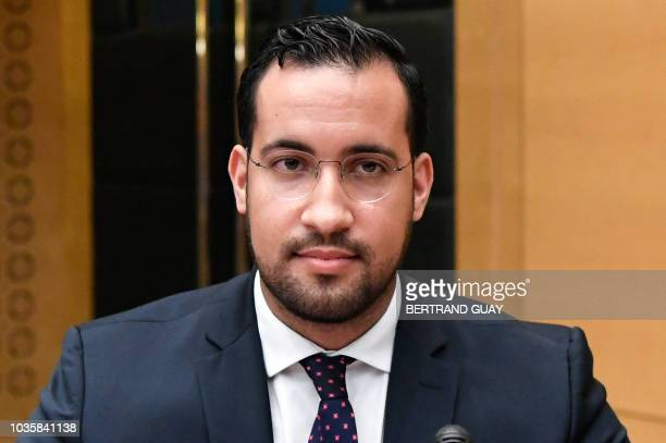 Former Elysee senior security officer Alexandre Benalla sits before a Senate committee in Paris on September 19 2018 The disgraced former bodyguard...