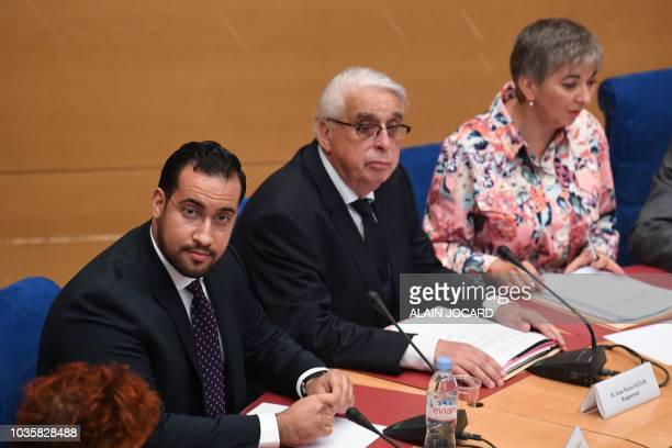 Former Elysee senior security officer Alexandre Benalla sits next to as he sits next to rapporteur JeanPierre Suer and rapporteur Mariel Jourda as he...