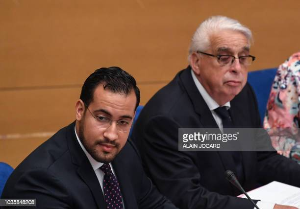 Former Elysee senior security officer Alexandre Benalla sits next to rapporteur JeanPierre Suer prior to the start of a Senate committee which will...