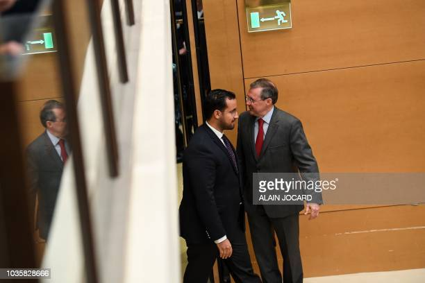 Former Elysee senior security officer Alexandre Benalla walks pas Philippe Bas the president of the Senate enquiry commission as he arrives for the...