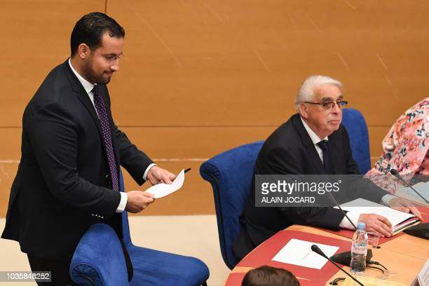 Former Elysee senior security officer Alexandre Benalla walks to his seat prior to the start of a Senate committee which will quiz him over his close...
