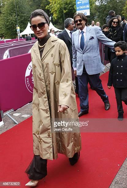 Former Emir of Qatar Sheikh Hamad ben Khalifa alThani and his wife Sheikha Mozah bint Nasser Al Missned attend the Qatar Prix de I'Arc de Triomphe at...