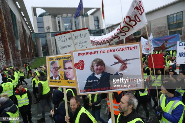 Former employees of German airliner Air Berlin march in front of the Chancellery while protesting on November 22 2017 in Berlin Germany Several...