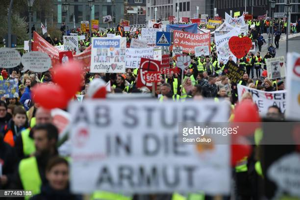 Former employees of German airliner Air Berlin march to protest in front of the Chancellery on November 22 2017 in Berlin Germany Several thousand...