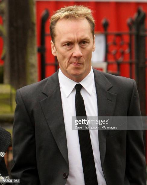 Former England and Arsenal footballer Lee Dixon arrives for a memorial service for Sara Roache, the wife of Coronation Street actor Bill, at St...