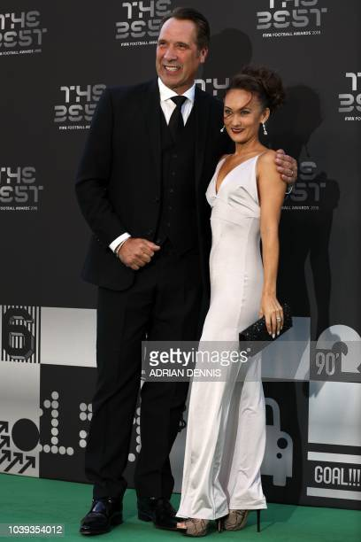 Former England and Arsenal goalkeeper David Seaman and his wife Frankie Poultney pose for a photograph as they arrive for The Best FIFA Football...