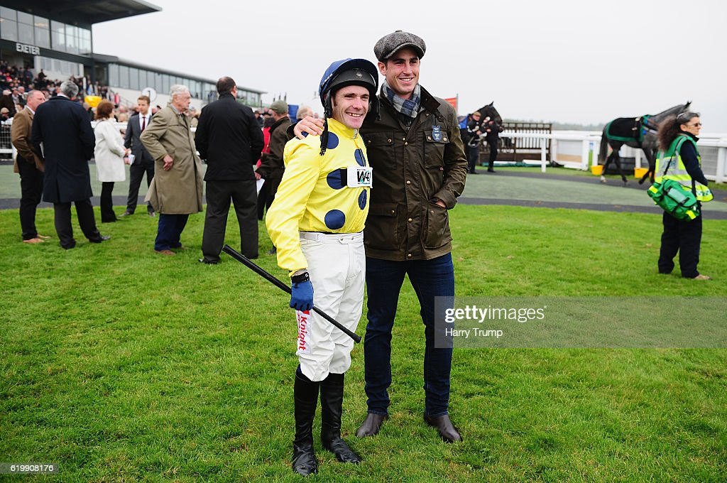 Former England and Somerset Cricketer now Horse Owner Craig Kieswetter (R) poses with Jockey Tom Scudamore at Exeter Racecourse on November 1, 2016 in Exeter, England.