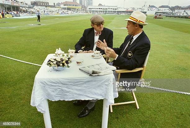 Former England and Yorkshire batsman Geoff Boycott chats over tea with BBC TMS commentator Henry Blofeld during a Test Match at Trent Bridge between...