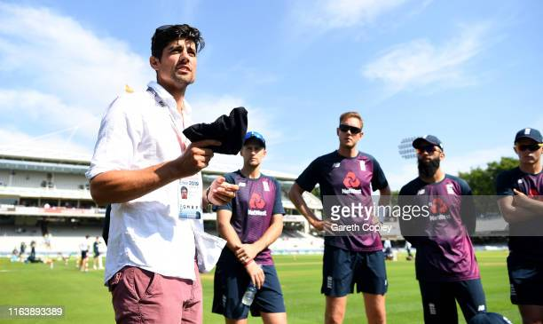 Former England captain Alastair Cook presents Jason Roy with his test cap ahead of day one of the Specsavers Test Match between England and Ireland...