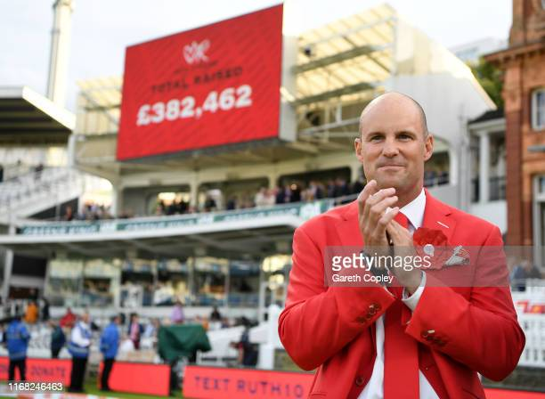 Former England captain Andrew Strauss applauds as the final total raised for the Ruth Strauss Foundation is announced at stumps on day two of the 2nd...