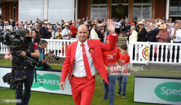 Former England captain Andrew Strauss leads out the teams alongside sons Luca and Sam ahead of day two of the 2nd Specsavers Ashes Test match at...