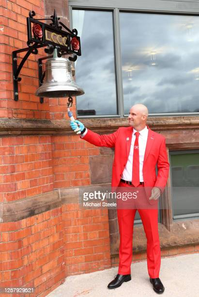 Former England Captain Andrew Strauss rings the bell prior to the start of Day One of the Ruth Strauss Foundation Test the Third Test in the...