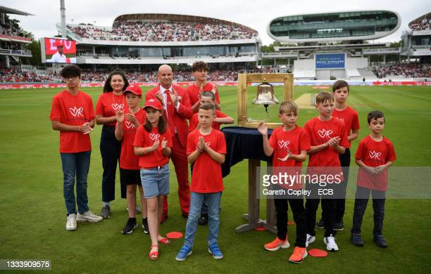 Former England captain Andrew Strauss rings the five minute bell alongside families with have been supported by the Ruth Strauss Foundation ahead of...