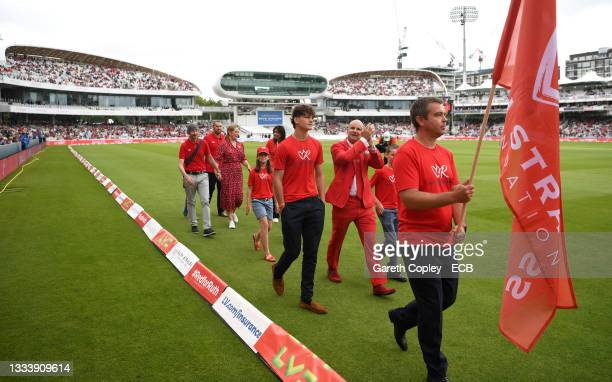 Former England captain Andrew Strauss walks round the outfield alongside families with have been supported by the Ruth Strauss Foundation ahead of...