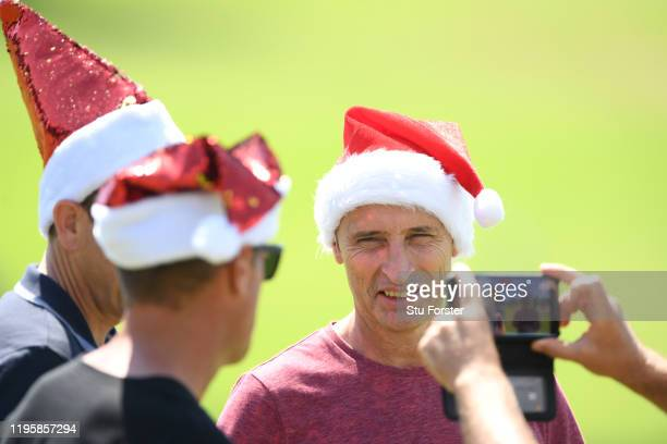 Former England captain, Journalist and Broadcaster, Nasser Hussain dons a Santa hat during an England nets session ahead of the First Test Match...