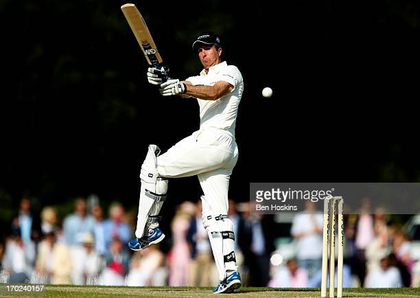 Former England Captain Michael Vaughn hits out during Shane Warne's Australia vs Michael Vaughan's England T20 match at Cirencester Cricket Club on...