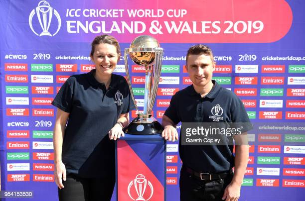 Former England captains James Taylor and Charlotte Edwards pose with the Cricket World Cup during the Cricket World Cup 2019 Volunteers Launch event...