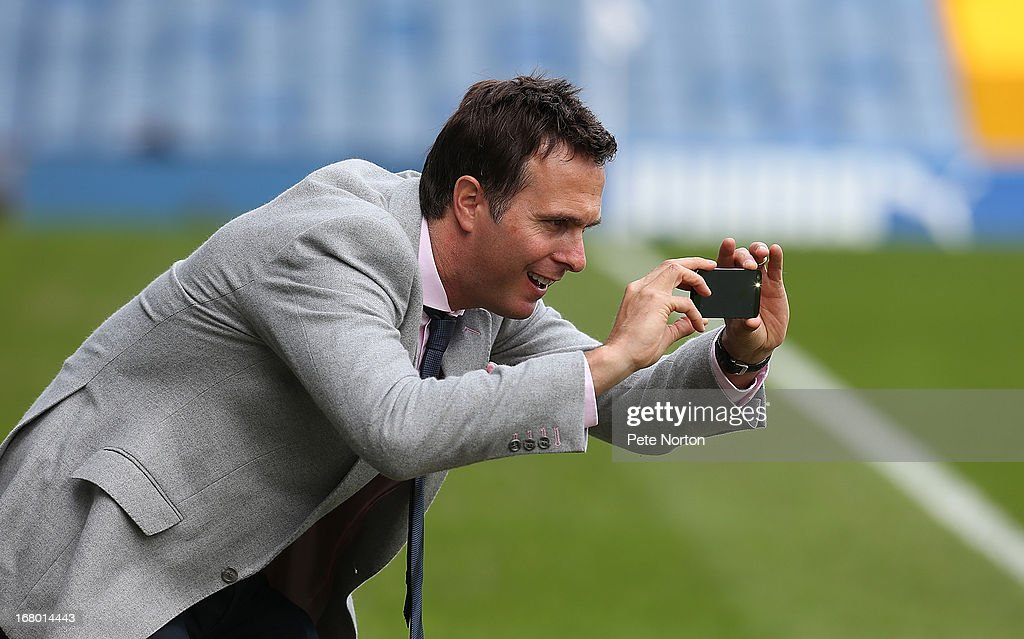 Former England cricket captain and Sheffield Wednesday fan Michael Vaughan takes a picture of his son who was a mascot on his mobile phone prior to the npower Championship match between Sheffield Wednesday and Middlesbrough at Hillsborough Stadium on May 4, 2013 in Sheffield, England.