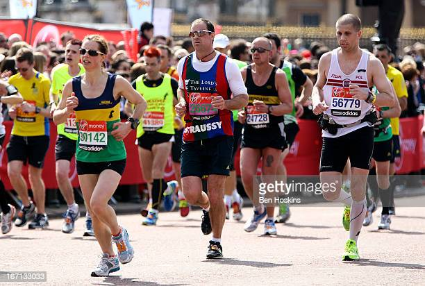 Former England cricket captain Andrew Strauss makes his way towards the finish line during the Virgin London Marathon 2013 on April 21 2013 in London...