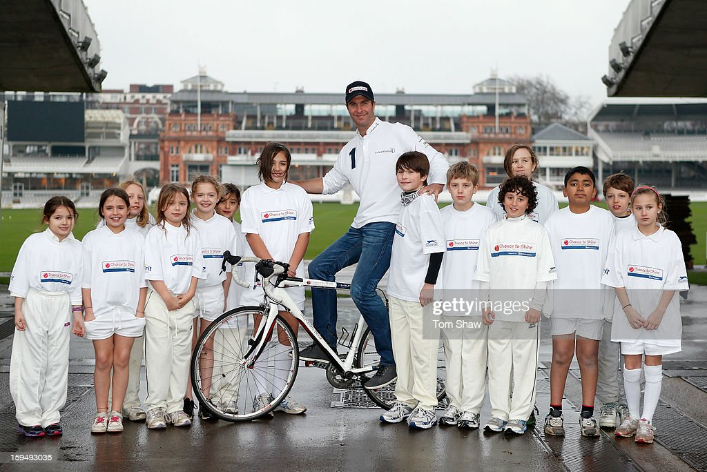 Former England cricket captain Michael Vaughan poses for a picture with children from Chance to Shine, to launch the Michael Vaughan Charity Bike Ride to raise funds for the Laureus Sport for Good Foundation and Chance to Shine, on January 14, 2013 in London, England.