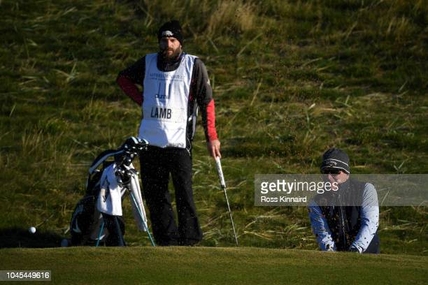 Former England cricket player Allan Lamb plays out of a bunker on the first during day one of the 2018 Alfred Dunhill Links Championship at...