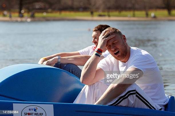 Former England cricketer Andrew Freddie Flintoff reacts next to friend and England cricketer Steve Harmison after a successful attempt to break the...