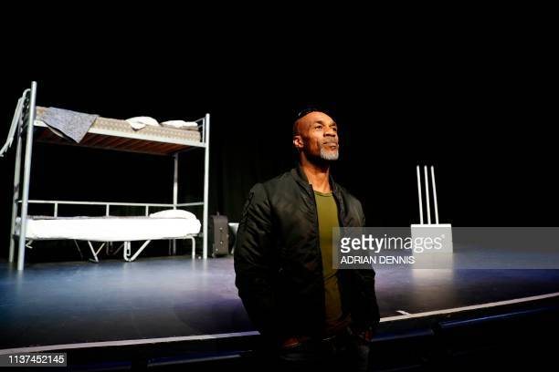 Former England cricketer Chris Lewis poses for a photograph in front of the stage set for rehearsal of a play about his life entitled 'A Long Walk...