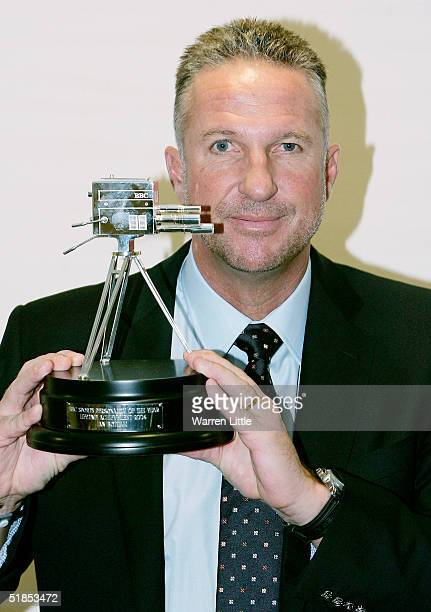 Former England cricketer Ian Botham poses with the Lifetime Achievement Award during the BBC Sports Personallity of the Year Award on December 12,...