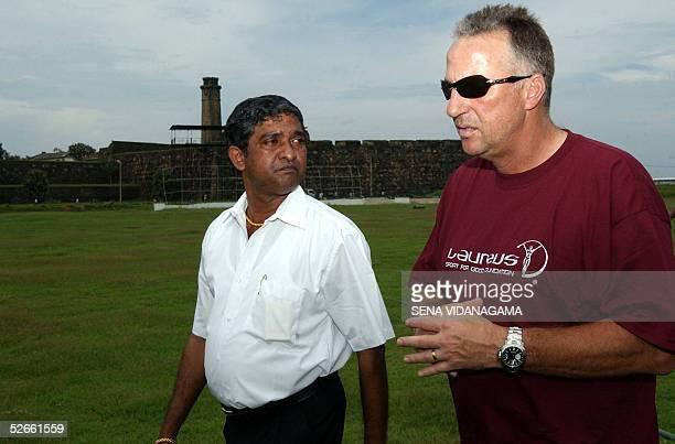 Former England cricketer Ian Botham walks with stadium curator Jayananda Warnaweera at the Galle International Cricket Stadium in Galle 20 April 2005...