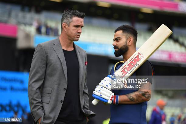 Former England Cricketer Kevin Pietersen chats with Virat Kohli of India during the Group Stage match of the ICC Cricket World Cup 2019 between...