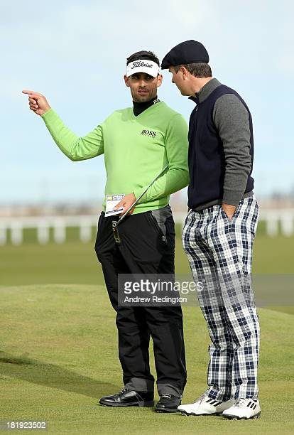 Former England cricketer Michael Vaughan with his playing partner Lee Slattery during the first round of the Alfred Dunhill Links Championship on The...
