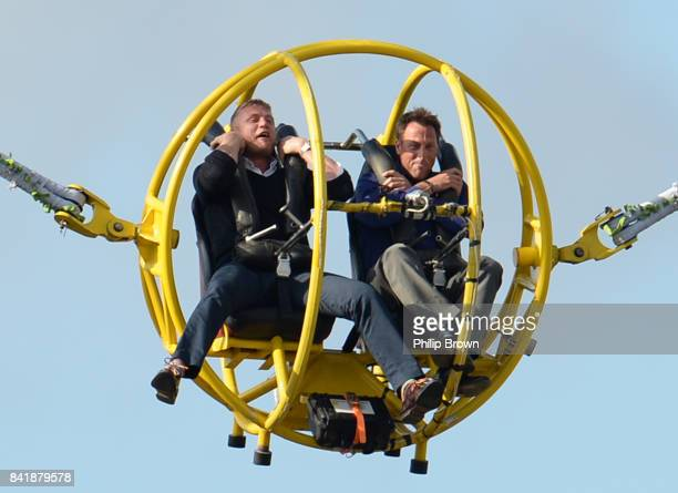 Former England cricketers Andrew 'Freddie' Flintoff and Marcus Trescothick in a bungee ride during the Natwest T20 Blast semifinal match between...
